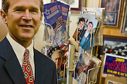 Crawford, Texas, USA..Bush Pappfigur und Bush Postkarten im Red Bull Souvenierladen von Jamie Burgess (44)..Bush stand up figure and postcards at the souvenir shop 'Red Bull'  on Crawford's Lone Star Parkway, store owner is Jamie Burgess (44)..Crawford, Texas, is the hometown of outgoing President George W. Bush, who bought the Prairie Chapel Ranch, located seven miles (10 km) northwest of town, in 1999. The farm was considered the Western White House of the President, who is leaving soon for a new home in  Dallas. His departure will bring major changes to this small town (population: 705), which had in part made a living by catering to the tourist, press and protesting crowds that came to visit. At the same time they are very tired of it all and seem to be glad that life can finally get back to normal now...©Stefan Falke