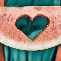 Teen with watermelon slice.