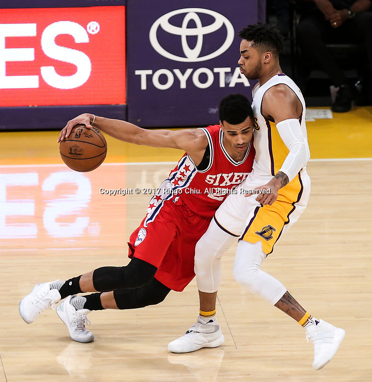 Philadelphia 76ers guard Timothe Luwawu-Cabarrot (#20) drives against Los Angeles Lakers guard D&rsquo;Angelo Russell (#1) during an NBA basketball game Tuesday, March 12, 2017, in Los Angeles. <br /> (Photo by Ringo Chiu/PHOTOFORMULA.com)<br /> <br /> Usage Notes: This content is intended for editorial use only. For other uses, additional clearances may be required.