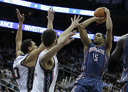 Apr 11; Newark, NJ, USA; Charlotte Bobcats guard Gerald Henderson (15) takes a shot over New Jersey Nets center Brook Lopez (11) and New Jersey Nets center Dan Gadzuric (50) during the second half at the Prudential Center. The Bobcats defeated the Nets 105-103.