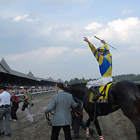 Calvin Borel celebrates with Street Sense after winning the Travers Stakes.