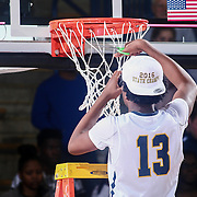 Sanford Warriors Forward JYARE DAVIS (13) cuts a piece of the net during celebration on the floor after Sanford wins the Delaware Boys Basketball DIAA State Tournament for the eight time in school history by defeating the St. Georges Hawks 39-32 Saturday, Mar. 12, 2016, at The Bob Carpenter Sports Convocation Center in Newark, DEL.