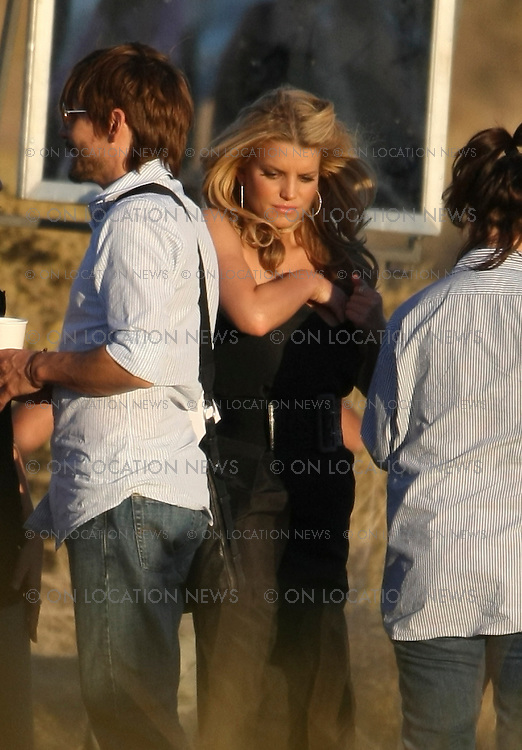 Mojave Desert, CALIFORNIA. Monday, October 20th 2008. ***WORLD EXCLUSIVE*** Jessica Simpson is photographed by Hollywood film director Brett Ratner during a photo shoot in the Mojave Desert. Jessica looked beautiful as she posed next to, on top of, and around an old Chevy pick up truck in the desert. The shoot lasted for 4 hours. Simpson changed her wardrobe multiple times and had her famous hairstylist and friend Ken Paves doing her hair. Brett Ratner had Simpson doing many sexy and provocative poses. Ratner also photographed another model taking off her clothes. The shoot was done on a small road which was not closed to traffic. stunned drivers were surprised to see Jessica Simpson as they passed by on this lonely stretch of desert road. Sales: Eric Ford 1/818-613-3955 info@onlocationnews.com