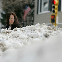 Belmont, MA -  Riham Hussein of Belmont waits for the 73  bus amongst the piles of snow on Trapelo Road on January 28, 2010.  Photo by Matthew Healey