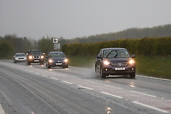 © Licensed to London News Pictures. 25/04/2017. Driffield, UK. Cars drive through an icy hail shower in Driffield, East Yorkshire  Forecasters are predicting cold temperatures in Britain this week as it is set to be hit by an arctic blast. Photo credit : Ian Hinchliffe/LNP