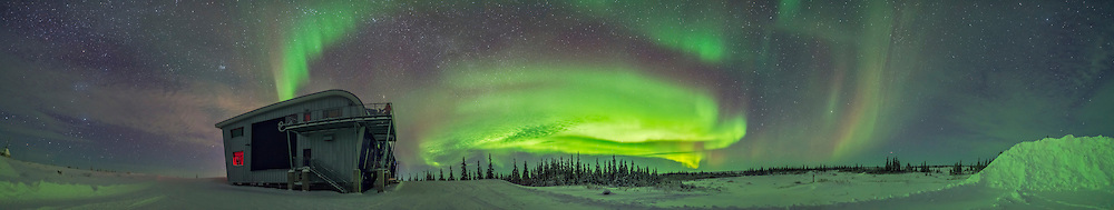 A 210&deg; panorama from southwest to northeast taking in the full sweep of the auroral arcs this night, January 29, 2017 at the Churchill Northern Studies Centre, on the shore of Hudson Bay in Churchill, Manitoba. Orion is at far left. The Pleiades is over CNSC. Arcturus is at right amid a bit of an isolated arc to the east.<br /> <br /> This is a stitch of 9 segments, each 15 seconds at f/2 with the Sigma 20mm Art lens and Nikon D750 at ISO 3200. Stitched with Adobe Camera Raw.