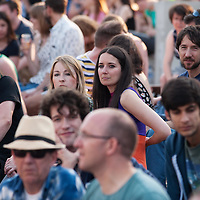 GLASGOW, UNITED KINGDOM - JULY 23: Music fans at the Kelvingrove Bandstand watch Belle and Sebastian perform on stage as part of the Glasgow 2014 Commonwealth Games celebrations at Kelvingrove Bandstand on July 23, 2014 in Glasgow, United Kingdom. Photo by Ross Gilmore