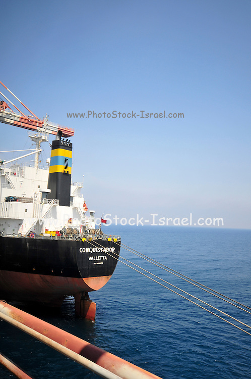 Israel, Hadera, The Orot Rabin coal operated power plant. Ship unloads coal at the pier