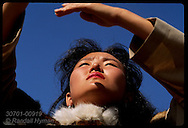 Costumed woman waves hands in air during ritual dance of ancient Olonkho epic;Ysyakh fest/Yakutsk Russia