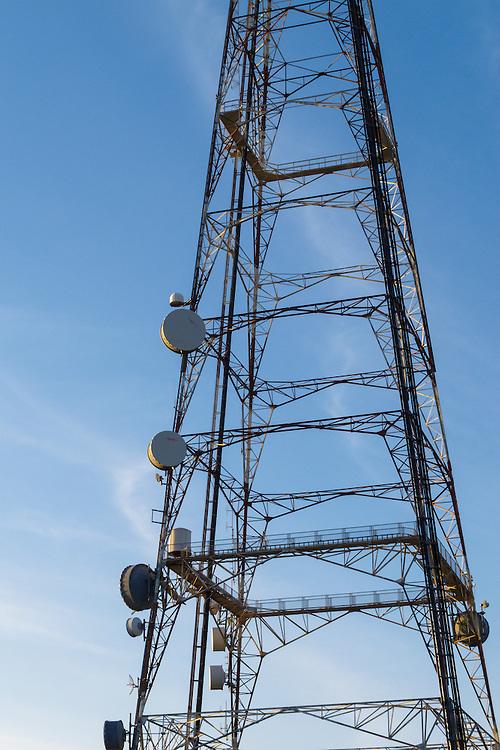 Microwave dish antenna on television broadcast transmission lattice tower at sunrise on Mt Coot-tha, Brisbane, Queensland, Australia