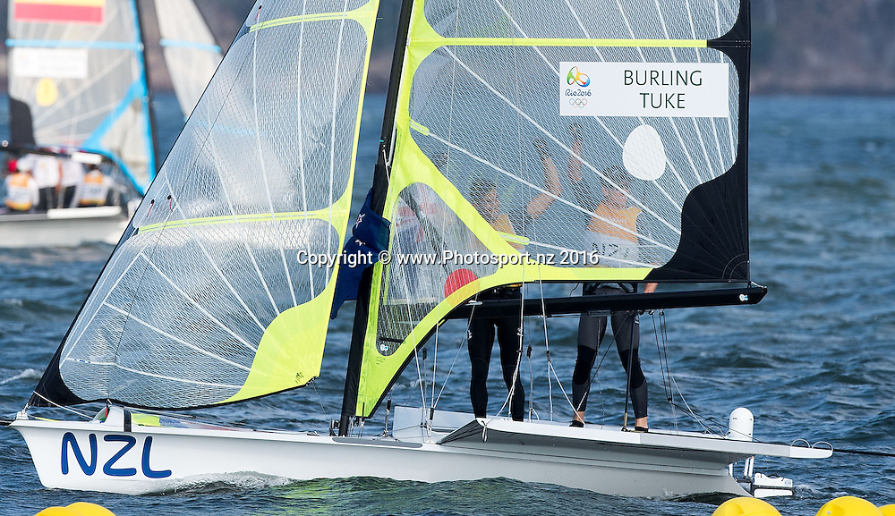 Peter Burling and Blair Tuke celebrate winning gold for the 49er class sailing race the 2016 Rio Olympics on Thursday the 18th of August 2016. © Copyright Photo by Marty Melville / www.Photosport.nz