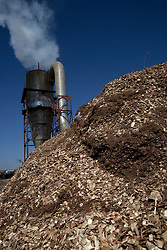 A pile of chip wood beside a funnel is seen in a logging yard in Kunlun Qi in the Inner Mongolia Autonomous Region of China on 25 April 2011. Inner Mongolia, China's third largest province, is fighting severe desertification, much like the provinces of Xinjiang, Gansu, Qinghai, Ningxia, Shaanxi, Heilongjiang and Hebei. Over-grazing, logging, expanding farms and population pressure, along with droughts have steadily turned once fertile grasslands into sandy plains. China has adopted measures to stop the land degradation such as reforestation, resettling nomadic Mongolians from grasslands to urban areas and restricting grazing areas. Tree planting has become a key government effort to combat desertification and supporting the government's reforestation endeavors are numerous non-governmental organizations (NGOs), such as Shanghai Roots & Shoots. The NGO launched the Million Tree Project in 2007 in Kulun Qi with aims to plant its first million trees by 2014 to hinder the expanding desert. To-date, they have planted more than 600,000 trees.