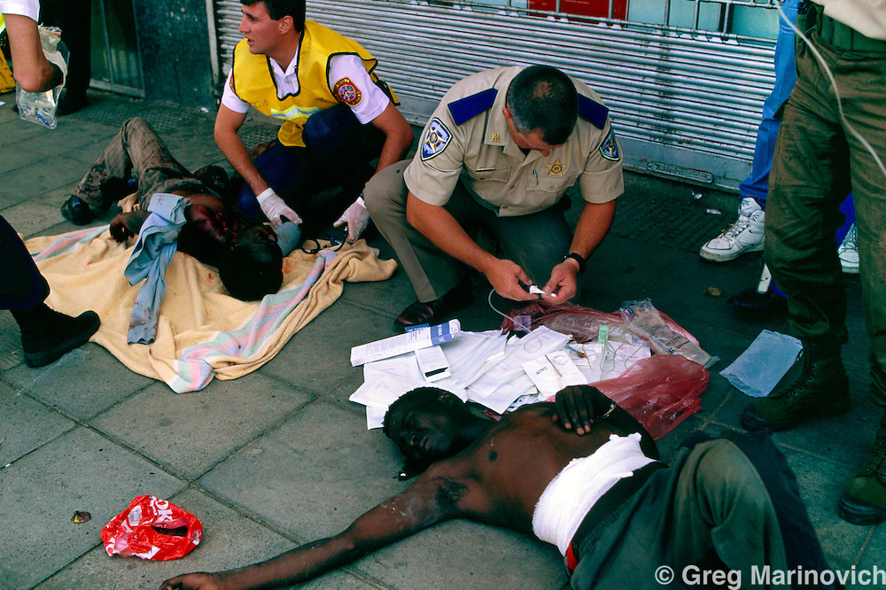 Johannesburg, South Africa, 1994. Medics treated the wounded after African National Congress guards opened fire on Inkatha Freedom Party marchers when they approached the ANC headquarters of Shellhouse, Johannesburg 1994. Many IFP supporters killed and wounded. Others were shot from the rooftops by persons unknown at the nearby Library Gardens. Johannesburg, South Africa
