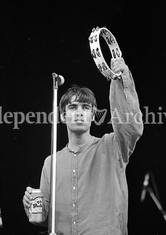 Liam Gallagher of Oasis on stage at Slane during their concert, 22/07/1995 (Part of the Indeoendent Newspapers Ireland/NLI Collection).