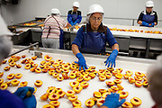 Peach pits are removed at Wawona Frozen Foods in Fresno, Calif., September 24, 2012. Wawona provides fruit for the USDA school lunch program through a federal contract.