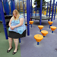Gabi Jones sits in a playground in a park during a photo shoot for her website in a suburb of Denver April 12, 2010.  Jones (not her real name) weighs 502 pounds and is an advocate of size acceptance, using her modeling to inspire those who have low self-esteem.  REUTERS/Rick Wilking  (UNITED STATES)