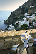 A moped is parked on the cliff side roads of the Amalfi Coast is Positano, Compania, Italy.