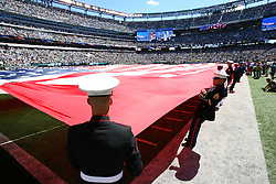Sept 9, 2012; East Rutherford, NJ, USA; The Honor Guard holds a field size American Flag before the first half at MetLIfe Stadium.
