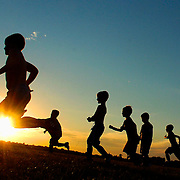 Members of the Cosmos U7 boys SOKy Soccer team practice as the sun sests at Lovers Lane Soccer Complex under the direction of coach Peter Klein. The team was preparing for the Owensboro Invitational Tourney.