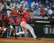 Ole Miss' Miles Hamblin singles in the 7th inning, scoring Ole Miss' Tanner Mathis vs. Auburn during the Southeastern Conference tournament at Regions Park in Hoover, Ala. on Friday, May 28, 2010.  (AP Photo/Oxford Eagle, Bruce Newman)