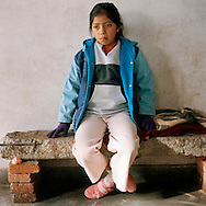 Rosita's daughter.Warmi Sayajsungo is a women's organization based in Argentina that helps women become self-sufficient. Rosario Quispe, who has seven children, and is the wife of an unemployed miner, founded the organization of indigenous Coya in 1995, called Warmi Sayajsungo, which in quechua means Women's Perseverance. Rosario had an ambitious dream for the Coya people who lived high on the arid plateau where Argentina and Bolivia meet, in the shadow of the Andes. That dream was that one day they would live in dignity on the fruits of their own work. They are taught skills and given micro credits to help their small businesses prosper.Each person photographed has their own story to tell about their life now and how the organization changed their lives for the better.