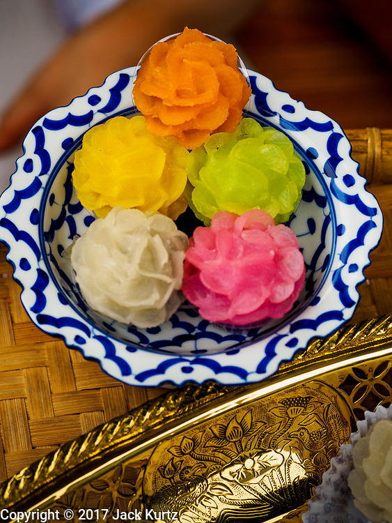 """08 APRIL 2017 - BANGKOK, THAILAND: Samples of traditional Thai desserts at the """"Amazing Songkran"""" festival in Benchasiri Park in Bangkok. The festival was sponsored by the Tourism Authority of Thailand to highlight the cultural aspects of Songkran. Songkran is celebrated in Thailand as the traditional New Year's Day from 13 to 16 April. Songkran is in the hottest time of the year in Thailand, at the end of the dry season and provides an excuse for people to cool off in friendly water fights that take place throughout the country. Songkran has been a national holiday since 1940, when Thailand moved the first day of the year to January 1. Songkran 2017 is expected to be more subdued than Songkran usually is because Thais are still mourning the October 2016 death of revered King Bhumibol Adulyadej.       PHOTO BY JACK KURTZ"""