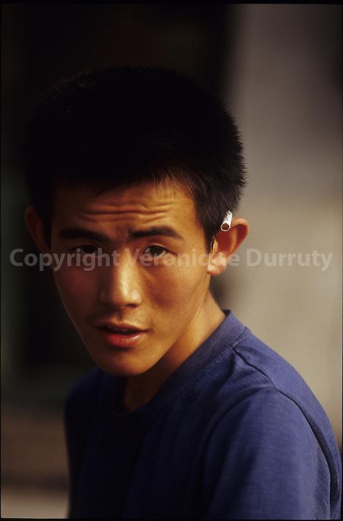 YOUNG MAN PORTRAIT. PINGYAO, SHANXI, CHINA
