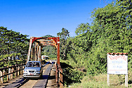 Car crossing a country bridge near San Carlos, Pinar del Rio, Cuba.