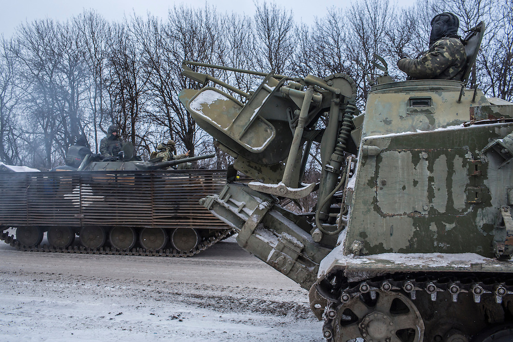 ARTEMIVSK, UKRAINE - FEBRUARY 16: Ukrainian soldiers drive in the direction of the embattled town of Debaltseve on February 16, 2015 in Artemivsk, Ukraine. A ceasefire that went into effect two days ago has been generally respected aside from Debaltseve, where pro-Russian rebels claim to have surrounded thousands of Ukrainian fighters and the battle continues. (Photo by Brendan Hoffman/Getty Images) *** Local Caption ***