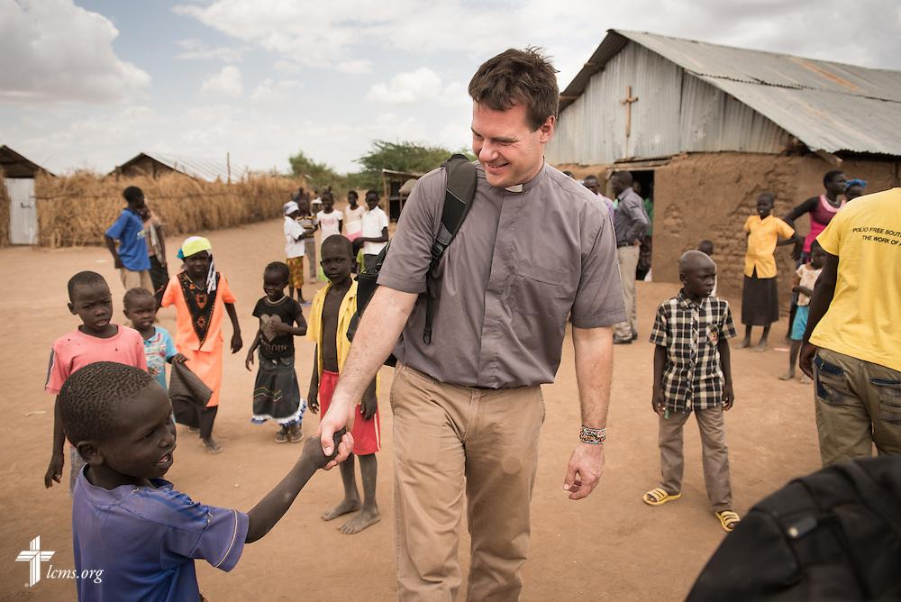 Photographs in congregations at Kakuma Refugee Camp on Saturday, Oct. 17, 2015, in Kakuma, Kenya. LCMS Communications/Erik M. Lunsford