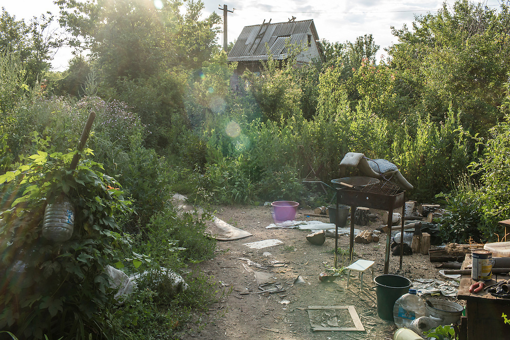 AVDIIVKA, UKRAINE - JULY 9, 2016: The yard of a house used by Ukrainian soldiers from the 58th brigade for sleeping and eating in Avdiivka, Ukraine. The town is now one of the most active areas of fighting along the line of control between the Ukrainian government and Russian-backed rebels. CREDIT: Brendan Hoffman for The New York Times