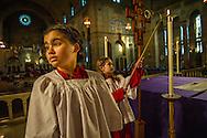 Preparing for Mass at Sacred Heart Catholic Church in Washington, D. C.