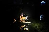 Bajau returning from night fishing