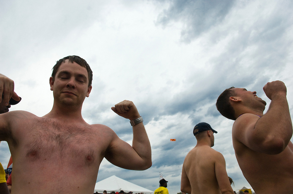 (staff photo by Matt Roth)..A drunken Brian Davis, age 24, from Towson, left, flexes after talking smack about his much bigger friend Justin Worman, from New Jersey. The two were roughhousing before the Preakness event staff broke up their shenanigans in the infield during the 132nd Preakness Stakes held at Pimlico Race Track Saturday May 19, 2007.