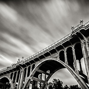 "Long Exposure photograph of the Colorado Street Bridge. The historical structure and famous landmark is known as ""Suicide Bridge"" to locals because of its dark history. It spans the Arroyo Seco in Pasadena, CA."