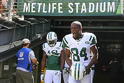 Sept 9, 2012; East Rutherford, NJ, USA; New York Jets wide receiver Stephen Hill (84) runs out of the tunnel during the pre-game warmup for their game against the Buffalo Bills at MetLIfe Stadium.
