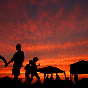 Who Owns the Blues? - The sun sets over the festival fields at the Hill Country Picnic in Potts Camp, Mississippi. The festival celebrates the legacies of departed North Mississippi blues legends and it features some of their children and grandchildren. The festival also offers blues workshops and camping on site.