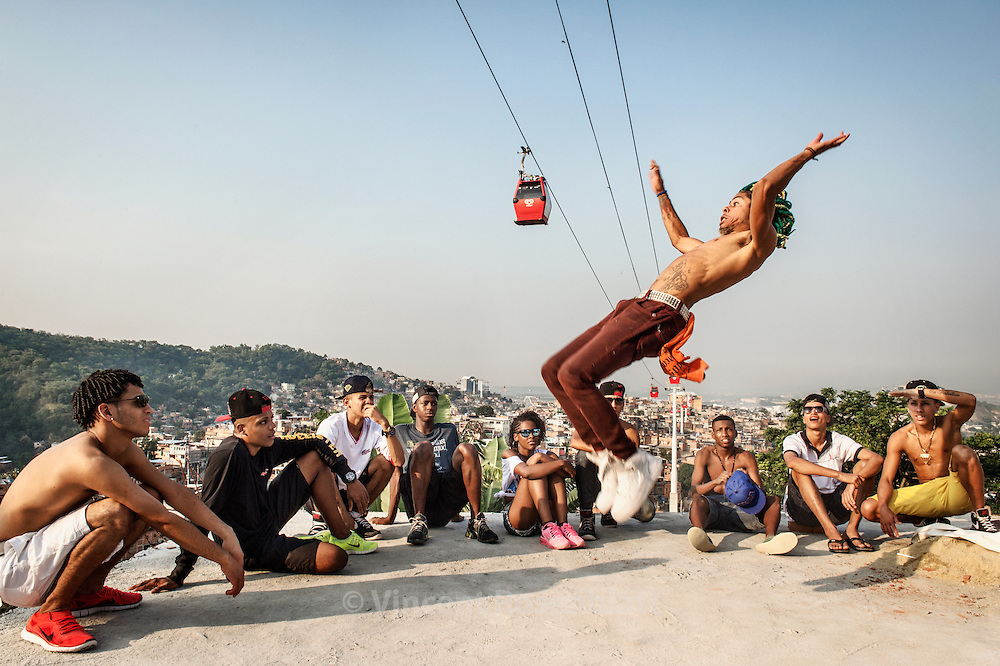 "Igor Pontes great Passinho, Funk & Hiphop dancer from the favela of Jacarézinho. Rehearsal of the show ""Na Batalha"" on a rooftop of the Complexo do Alemão favelas. Elite dancers of the ""Passinho"" (little step) the newest dance fever that came out the Baile Funk culture."