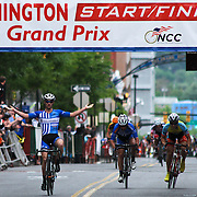 Luke Keough of team UnitedHealthcare Pro Cycling gestures victory as he crosses the finish line & wins the Seventh Annual Wilmington Grand Prix Saturday, May 18, 2013 in Wilmington, Del...
