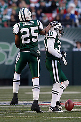 Nov 29, 2009; East Rutherford, NJ, USA; New York Jets safety Kerry Rhodes (25) congratulates New York Jets cornerback Drew Coleman (30) after he broke up a pass during the second half at Giants Stadium. The Jets defeated the Panthers 17-6.