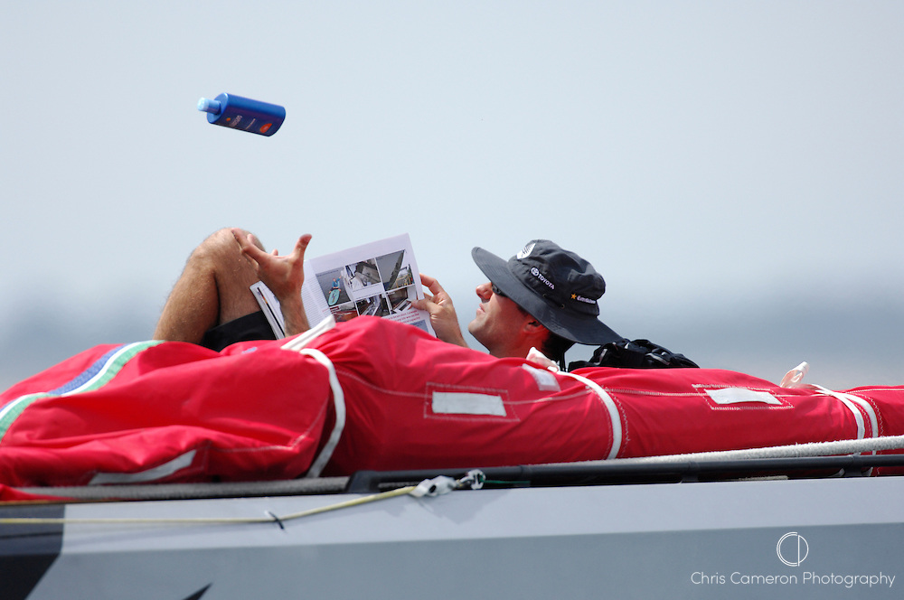 Emirates Team New Zealand bowman Jeremey Lomas gets in some reading on the foredeck of NZL92. Day six of the Louis Vuitton Cup is another wash out for lack of breeze. 21/4/2007