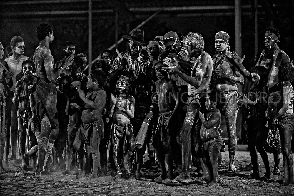 Elders and children preparing for a dance. Western Australia's largest indigenous corroboree is open to the public in Derby every month of July.  The corroboree gives the young people of the community's a chance to engage through dance, songs and art. Derby, Western Australia