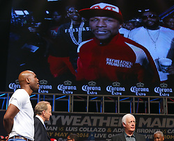 """LAS VEGAS, NV - MAY 2: Bernard Hopkins watches the screen as Floyd """"Money"""" Mayweather Jr.makes his way to the stage at the MGM Grand Garden Arena on May 2, 2014 in Las Vegas, Nevada. (Photo by Ed Mulholland/Golden Boy/Golden Boy via Getty Images) *** Local Caption ***Floyd Mayweather; Bernard Hopkins"""