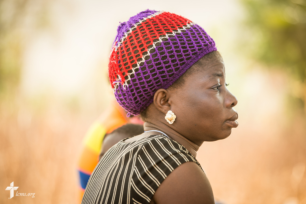 A woman listens as the Rev. Remi Lare Lambon of the Lutheran Church of Togo shares a devotion on Tuesday, Feb. 14, 2017, at a rural home in Sankpong, Togo.  LCMS Communications/Erik M. Lunsford