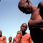 IPMG0365 South Africa, Flagstaff, 1998: Xhosa initiates apply mud during their seclusion, having undergone the circumcision rite of passage to manhood in tribal Xhosa culture in the former Transkei homeland, near Flagstaff, July 1998...Photograph by Greg Marinovich/South Photographs