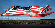 Wind whips a flag along a fenceline south of Burns, Oregon in Harney County, one of the largest and least populated counties in America some have called &quot;The Big Empty.&quot;<br />