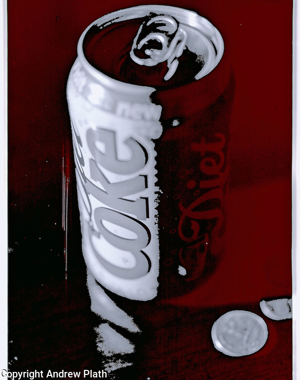 A colorized black and white image of a soda can and a quarter.  This was originally shot on Kodak T-Max 100 B&W film.