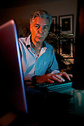 Internet Security specialist David Higgins at his Hanworth home. <br /> <br /> Photo by Mark Bullimore