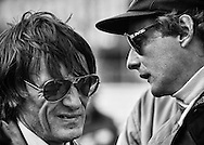 Two-time World Champion Niki Lauda delivers news of a possibly fatal oil leak in his Brabham Alfa Romeo to team owner Bernie Ecclestone before the start of the 1978 United States Grand Prix at Watkins Glen.  <br />