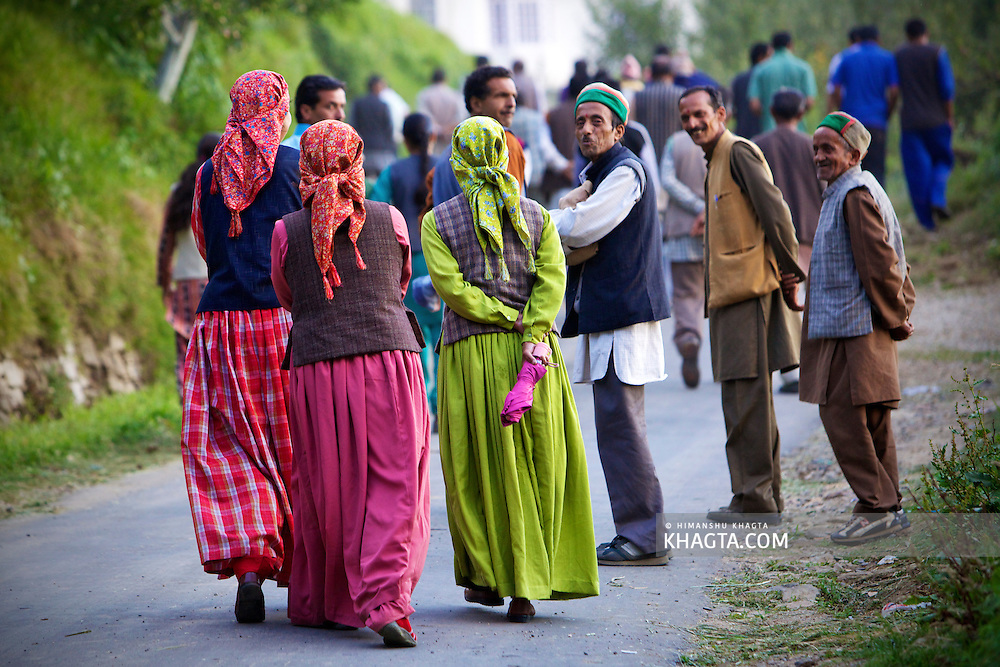 Thanedhar, Thanedar, Kotgarh, Narkanda People of Thanedhar Village of Kotgarh area dressed in colorful attire, talking to each other while coming back from a village festival.